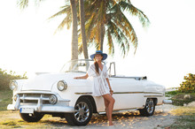 Happy Young Woman And Retro Convertible Car
