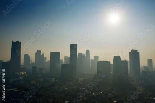 Fototapety, obrazy: Skyscrapers and residential houses with air pollution