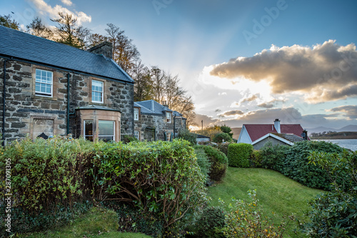 Sunset casts bright rays behind Stonefield Castle in Oban, Argyll and Bute, Scot Wallpaper Mural