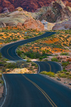 Travel Down A Winding Desert Road Toward Adventure
