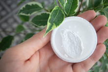 Round Box Of Mineral Powder In Female Palm In Natural Environment