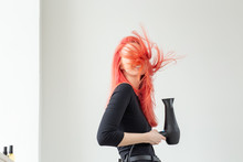 Hairdresser, Style, People Concept - Woman Is Blowing Dry Her Colored Hair