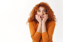 Scared Young Redhead Curly-haired Woman Biting Fingers, Trembling Fear, Realise Making Huge Mistake Worry Consequences, Afraid Being Fired, Stare Camera Frightened, Stand White Background