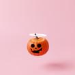 Leinwanddruck Bild - Halloween pumpkin with halo angel on pastel pink background. Creative idea. Minimal concept. 3d rendering
