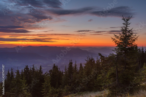 Wall Murals Forest Charming evening in the French Alpine mountains with stunning cliff peaks and dramatic skies