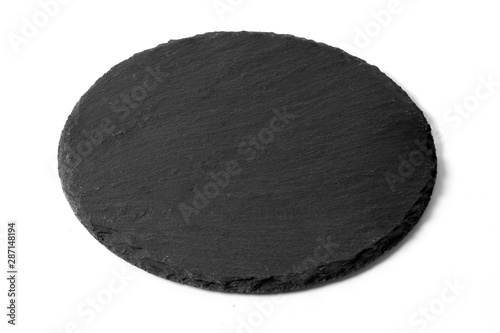 Black round stone plate isolated on white Wallpaper Mural