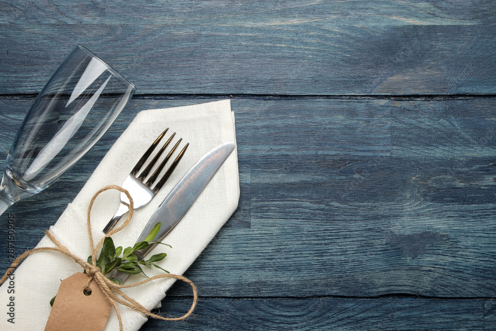 Fototapety, obrazy: table setting. cutlery. Wine glass Fork, knife in a white napkin on a blue wooden table. top view
