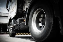 Truck Transportation, Closeup Wheels And Tires Of Semi Truck.