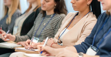Listeners Take Notes In Notebooks,sitting In The Conference Room