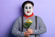 Positive Funny Mime With A Bun...