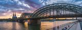 Cologne bridge with sunset and clouds