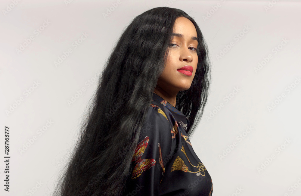 Fototapety, obrazy: gorgeous mixed race model in studido shoot with long wavy wig on