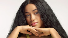 Beauty Mixed Race African American Model In Studio Portraits With Long Hair Wig Natural Makeup. Face Rest On Hands