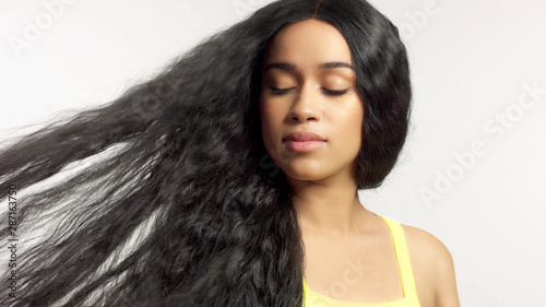 Obraz na plátně beauty mixed race african american model in studio portraits with long hair wig
