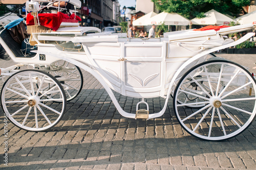Closeup white carriage in Krakow (Cracow ) on the street Wallpaper Mural