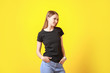 canvas print picture - Woman in stylish t-shirt on color background