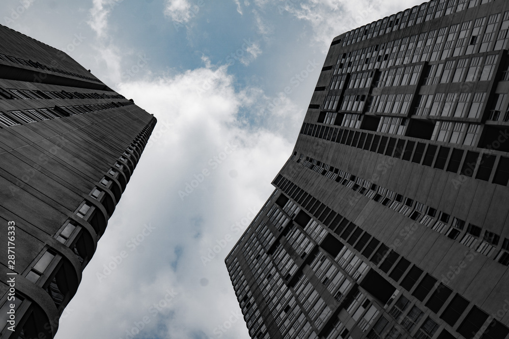 Fototapety, obrazy: Bottom view of modern skyscrapers over cloudy sky in Kuala Lumpur, Malaysia