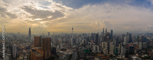 Aerial panorama of Kuala Lumpur city skyline during cloudy day, Malaysia Wallpaper Mural
