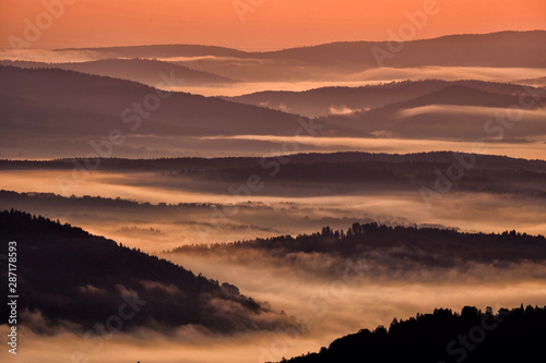 Foto auf Gartenposter Dunkelbraun Beautiful misty sunrise in the mountains. Bieszczady Mountains. Poland.