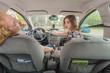 Woman encouraging sleepy man to drive