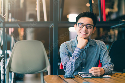 asian businessman startup company   entrepreneur  sit smile with happiness in ne Wallpaper Mural