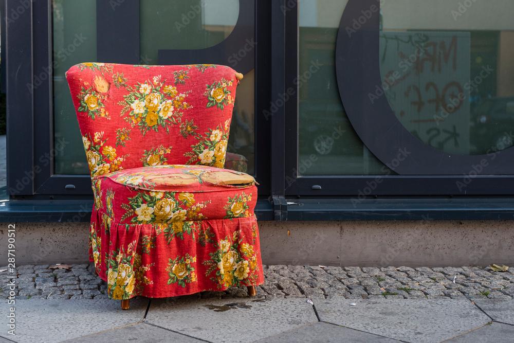Fototapeta An armchair on the sidewalk, bulky waste