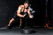Young muscular man with big sweaty muscles doing push ups workout training with clap his hand above the barbell weight plate on the gym floor with motion blur