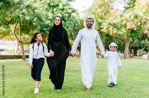 Fotografie, Obraz  Arabian family spending time in a park