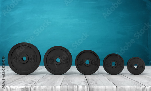 Fotomural  3d rendering of five black weight plates on white wooden floor and dark turquois