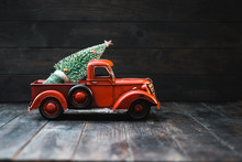 Red Toy Truck With A Christmas...
