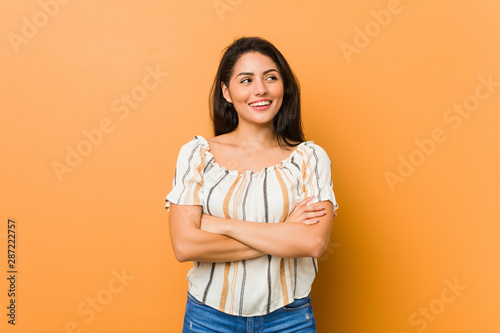 Young curvy woman smiling confident with crossed arms. Tablou Canvas