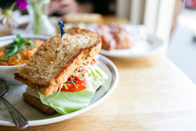 California Club Sandwich With Side Of Minestrone Soup On Table In Cafe, Close Up, Copy Space