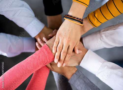 Fototapety, obrazy: Stack of hands. Unity and teamwork concept.