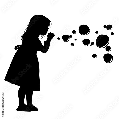 Valokuva Silhouette of a girl blowing soap bubbles. Vector illustration