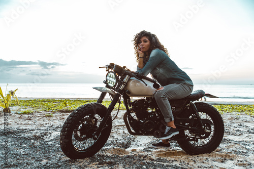 Beautiful woman making a  tour with her motorcycle Fotobehang