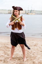 Young Caucasian Woman In Pirate Costume Crossed Toy Guns In Front Of Her.