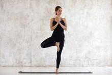 Beautiful Woman Practicing Yoga, Standing In Vrksasana, Tree Pose