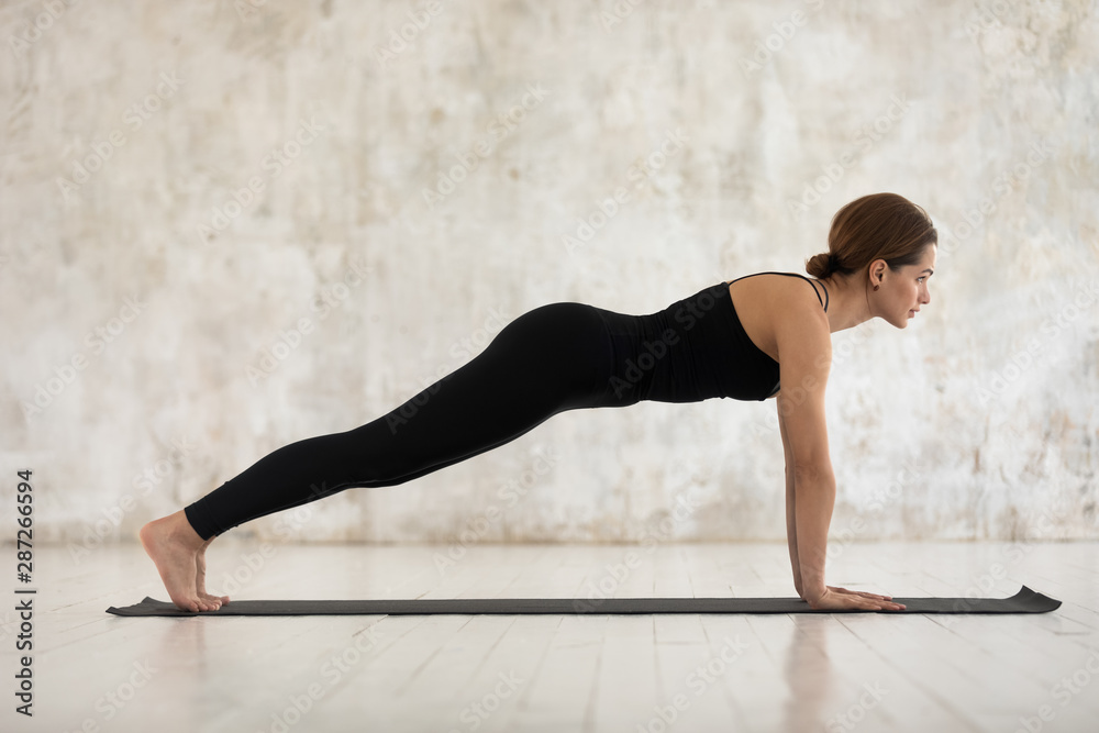 Fototapety, obrazy: Woman practicing yoga, Plank, Push ups or press ups exercise