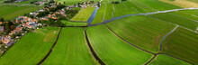 Top Down Aerial Panorama Of The Patterned Agrarian Green Pasture Fields With Its Irrigation Infrastructure Of Ditches And Trenches Surrounding The Small Traditional Village Of Ransdorp Near Amsterdam