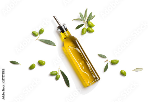 Olive oil in bottle and fresh olives. Above view.