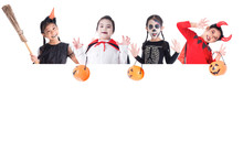 Group Of Asian Children In Halloween Costume And Makeup Holding  Pumpkin Bucket And Bloom Standing Behind White Board