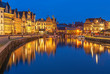 canvas print picture - Cityscape of Ghent (Gent) city during the blue hour with its historic flemish guild houses having a reflection in the Leie river, East Flanders, Belgium.
