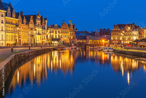 Foto op Canvas Brugge Cityscape of Ghent (Gent) city during the blue hour with its historic flemish guild houses having a reflection in the Leie river, East Flanders, Belgium.