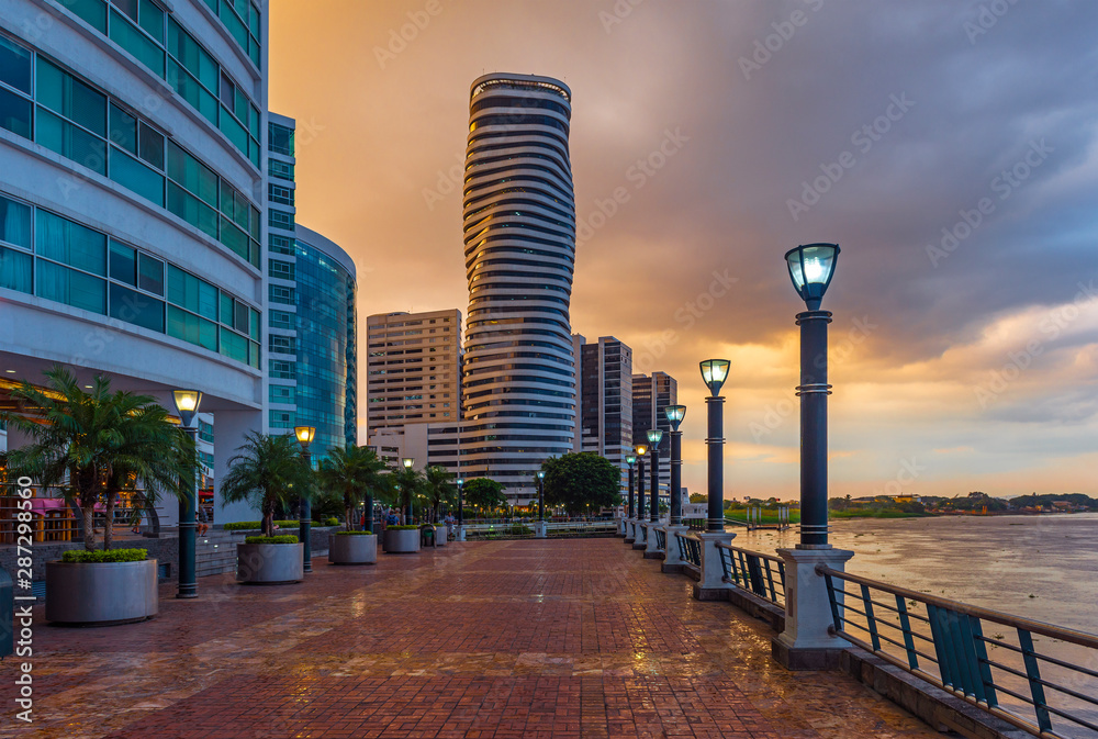 Fototapety, obrazy: Cityscape of Guayaquil city at sunset with a view over the Malecon 2000 waterfront, the Guayas river and the point skyscraper after a thunderstorm, Ecuador.