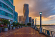 Cityscape of Guayaquil city at sunset with a view over the Malecon 2000 waterfront, the Guayas river and the point skyscraper after a thunderstorm, Ecuador.