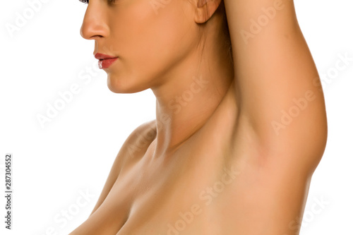Valokuva Beautiful woman showing her smooth underarm on white background