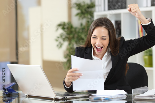 Fotografering Excited businesswoman reading good news in letter