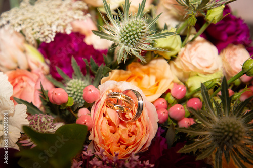 wedding bouquet and marriage rings close up