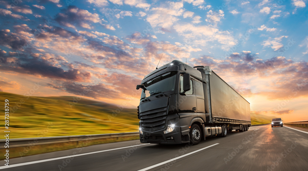 Fototapeta Truck with container on highway, cargo transportation concept. Shaving effect.