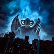 Leinwandbild Motiv Night of the demon / 3D illustration of horned devil with wings and trident rising above city under night sky
